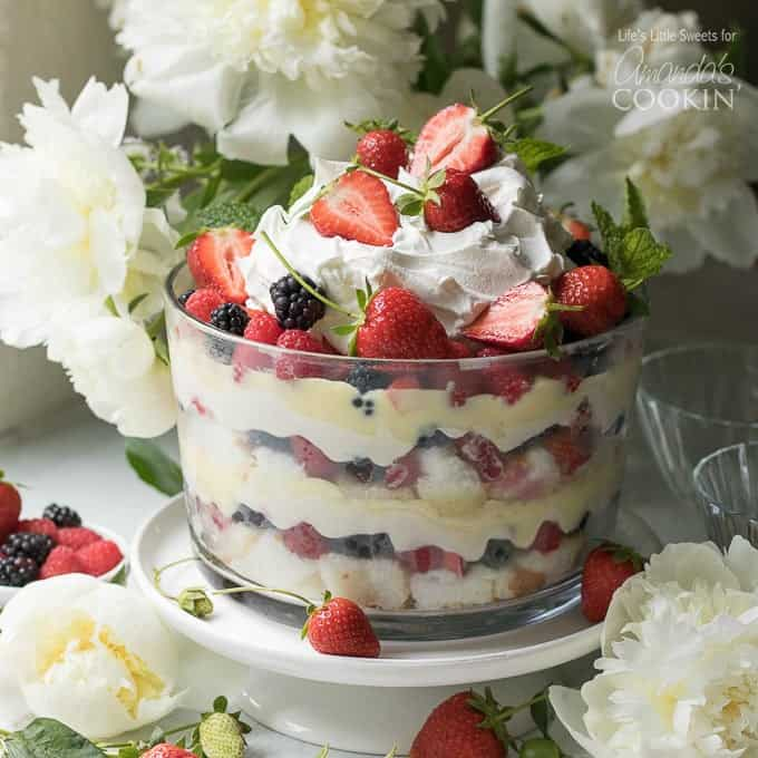 This mixed summer berry trifle recipe is a delightfully delicious no-bake dessert, perfect for warm weather events or Fourth of July. It has two layers of angel food cake, sweet vanilla-lemon cream cheese, vanilla pudding, mixed berries and topped with cool whip and more mixed berries.