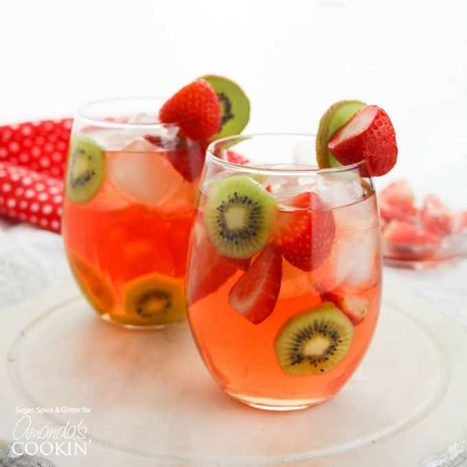 Strawberry kiwi sangria in wine glasses