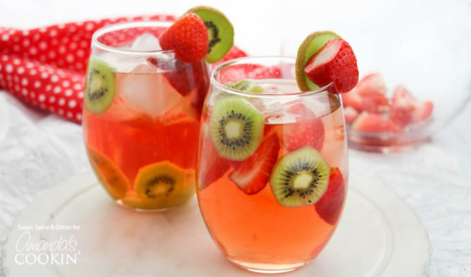 Strawberry Kiwi Sangria with kiwi and strawberry garnish