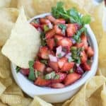 This Strawberry Salsa is naturally sweet, savory, refreshing and crisp. It has strawberries, a little heat from 1 jalapeño pepper, crisp red onion, with cilantro and optional maple syrup. Enjoy this full-flavored, fruit salsa that has garden-fresh flavors in an incredibly simple recipe!