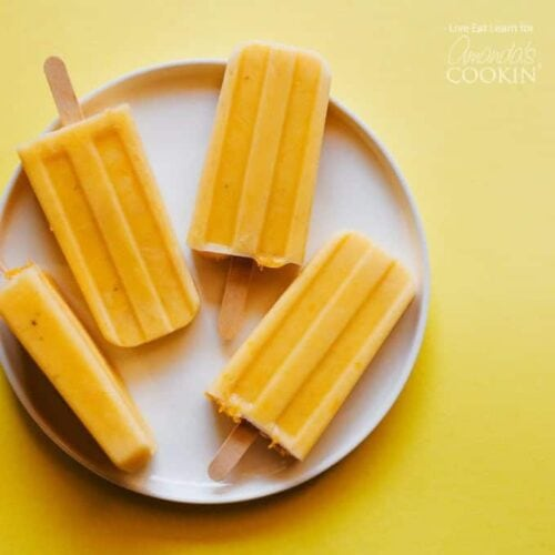 These Tropical orange Creamsicle Popsicles are a simple, delicious treat to help you cool off this summer (and they're healthy too!)