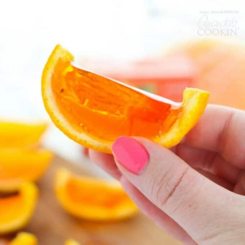These Orange Jell-O Shots are placed inside of hollowed-out orange rinds and then set to perfection. They make the perfect party treat!