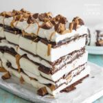 This peanut butter ice cream sandwich cake features layers of hot fudge, peanut butter, whipped topping and peanut butter cups.