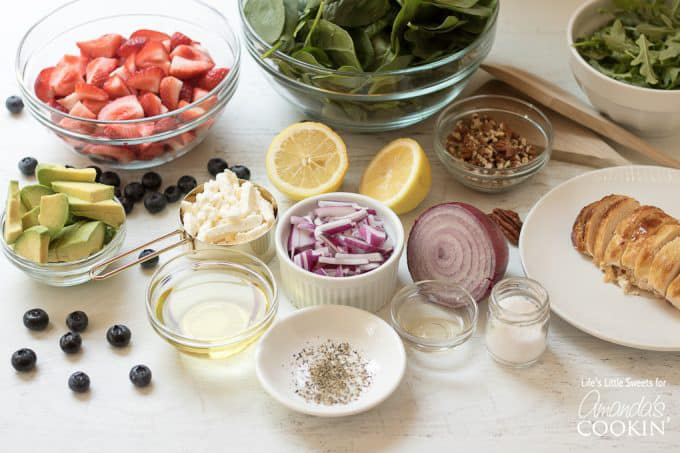 Ingredients for strawberry salad in bowls
