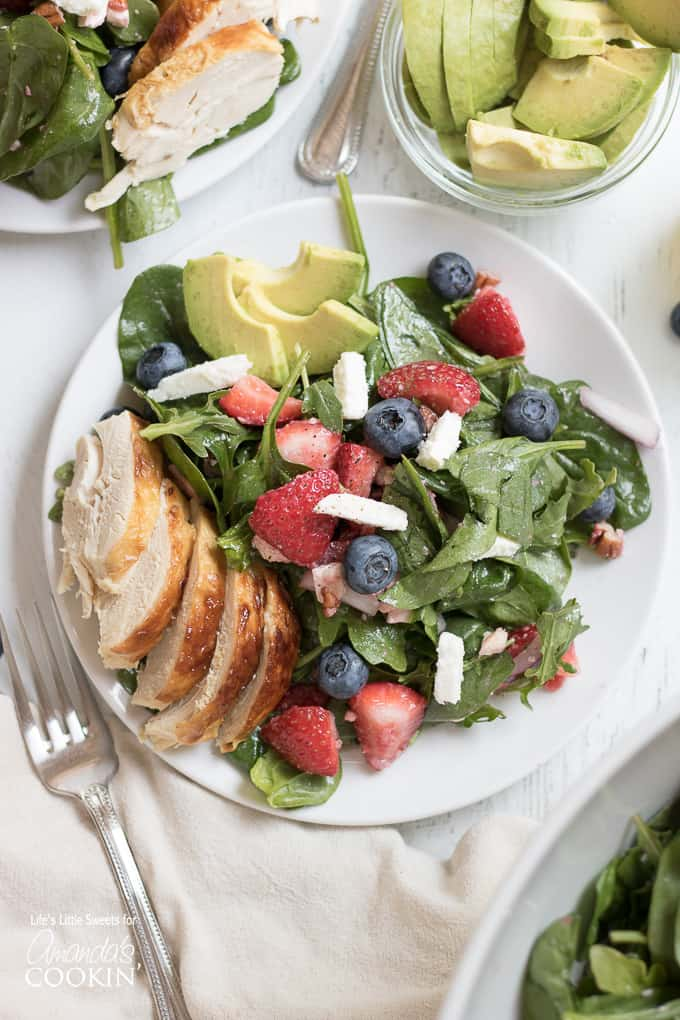 Strawberry Salad with blueberries, avocado, and chicken.