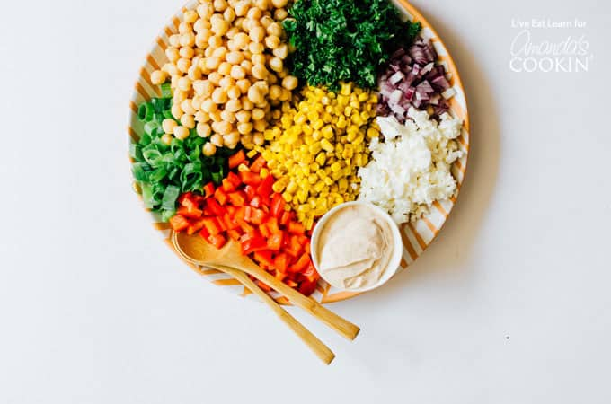 Platter with corn, chickpeas, and veggies to make sweetcorn and chickpea salad
