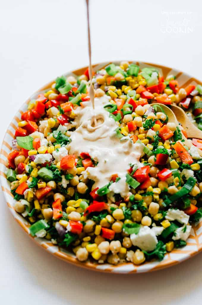 A flavorful combination of sweetcorn and chickpeas makes for the perfect summer salad!