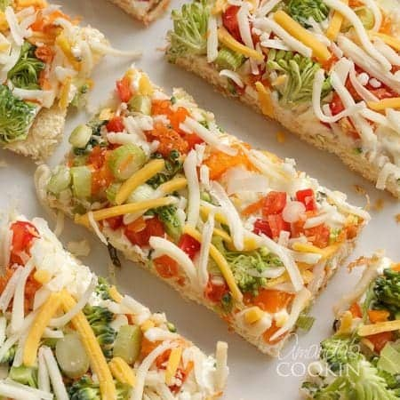 fresh veggies and cheese on cream cheese and crescent dough