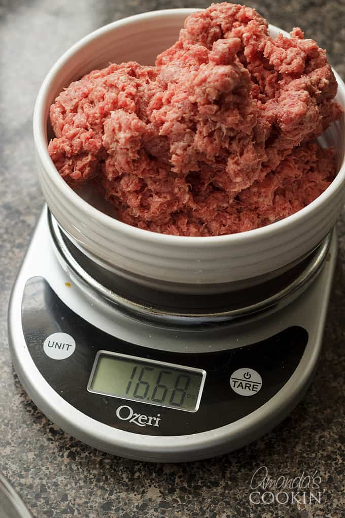 ground beef getting weighed on kitchen scale