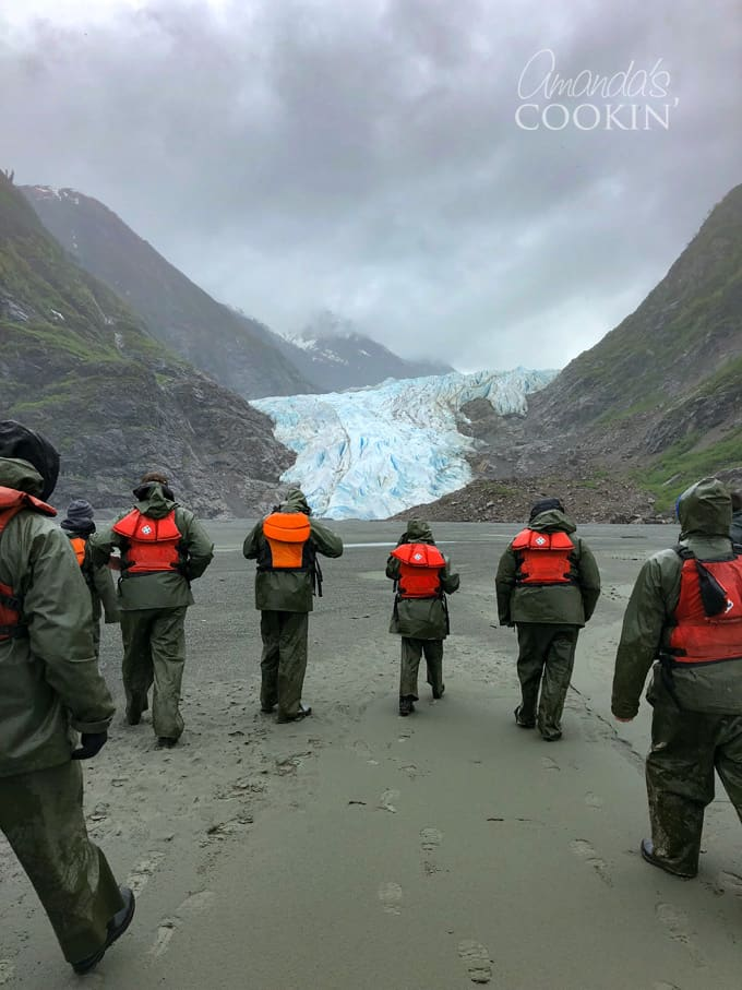 walk across black sand beach to davidson glacier in skagway, alaska