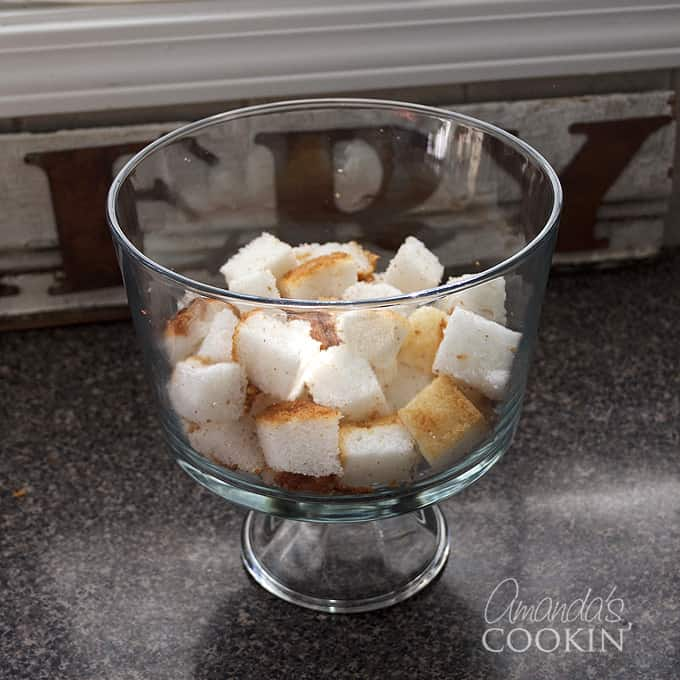 angel food cake cubes in a trifle bowl