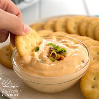 This warm Crockpot crack dip is a gooey combo of bacon, cheddar and ranch. It's only fitting this queso appetizer is called crack dip, it is so addicting!