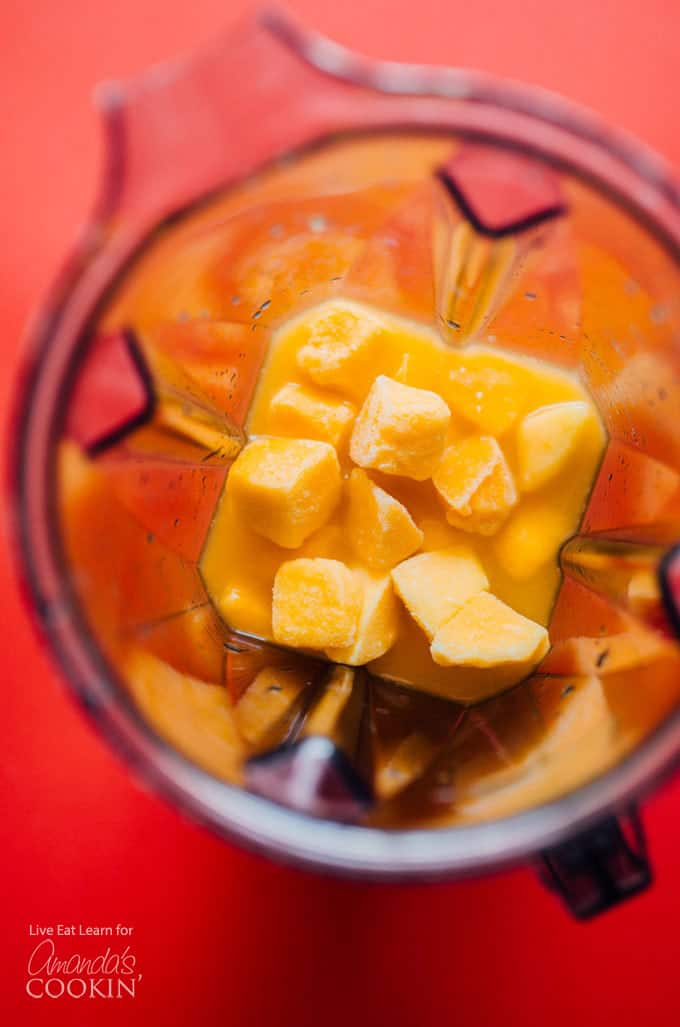 Frozen mangos in a blender