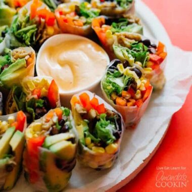 summer rolls on a plate with dip in the center