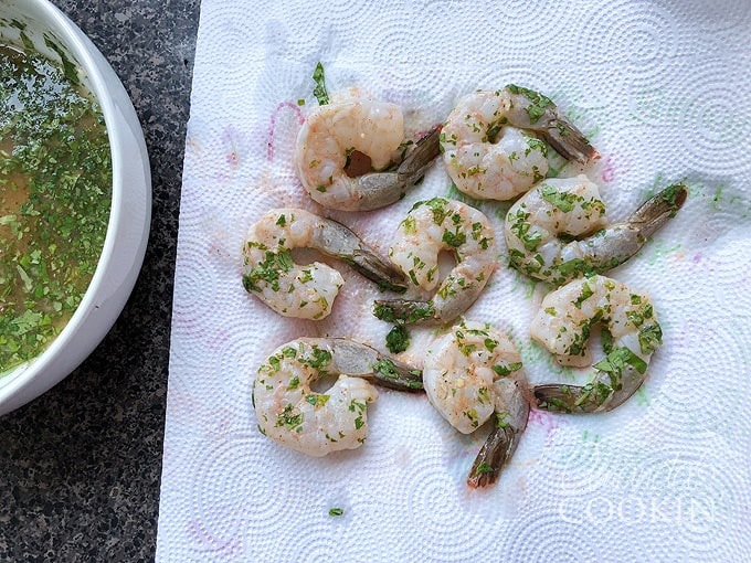 drain marinated shrimp on paper towels