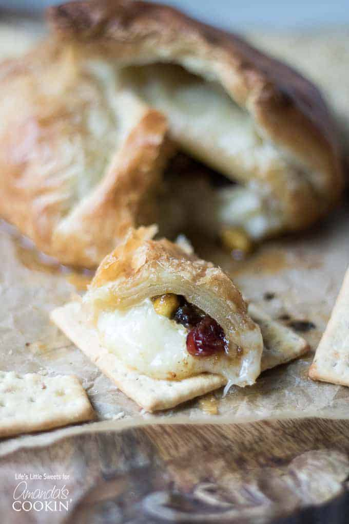 Baked Brie with fruits, nuts, and jam.