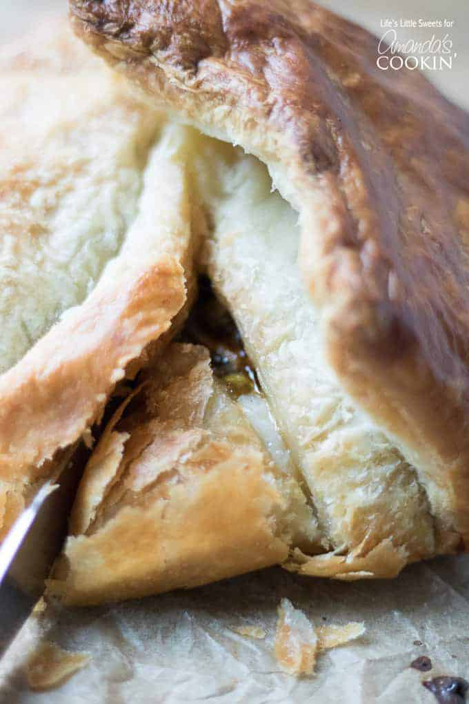 Cutting into the Baked Brie