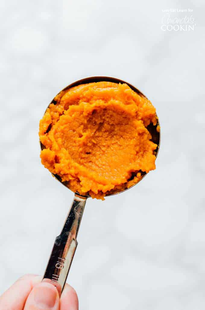 Pumpkin puree in a measuring cup