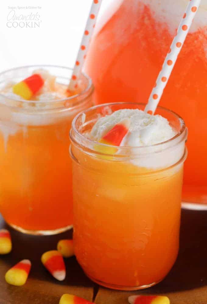 Candy corn punch in a glass with straws
