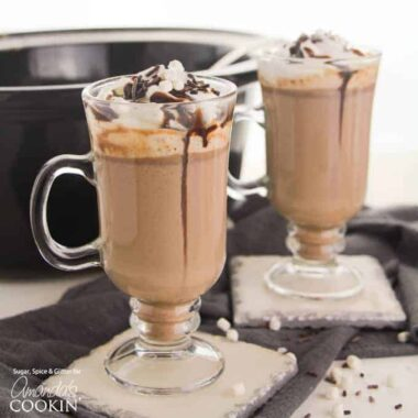 two glass mugs of hot chocolate