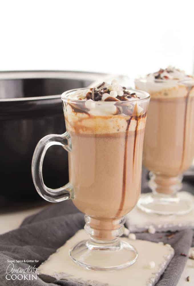 Hot chocolate in a mug with chocolate sauce and marshmallows
