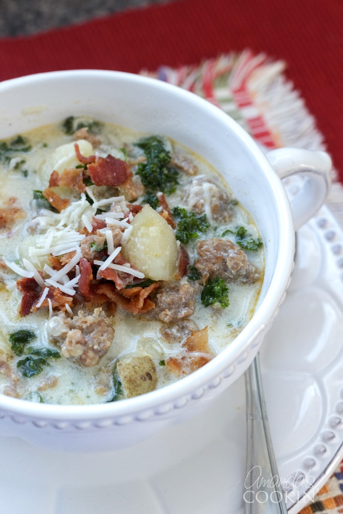 close up photo bowl of zuppa toscana soup