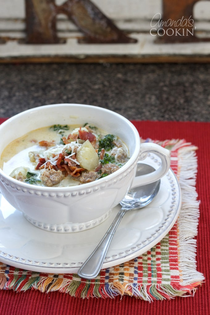 bowl of zuppa toscana on red placemat
