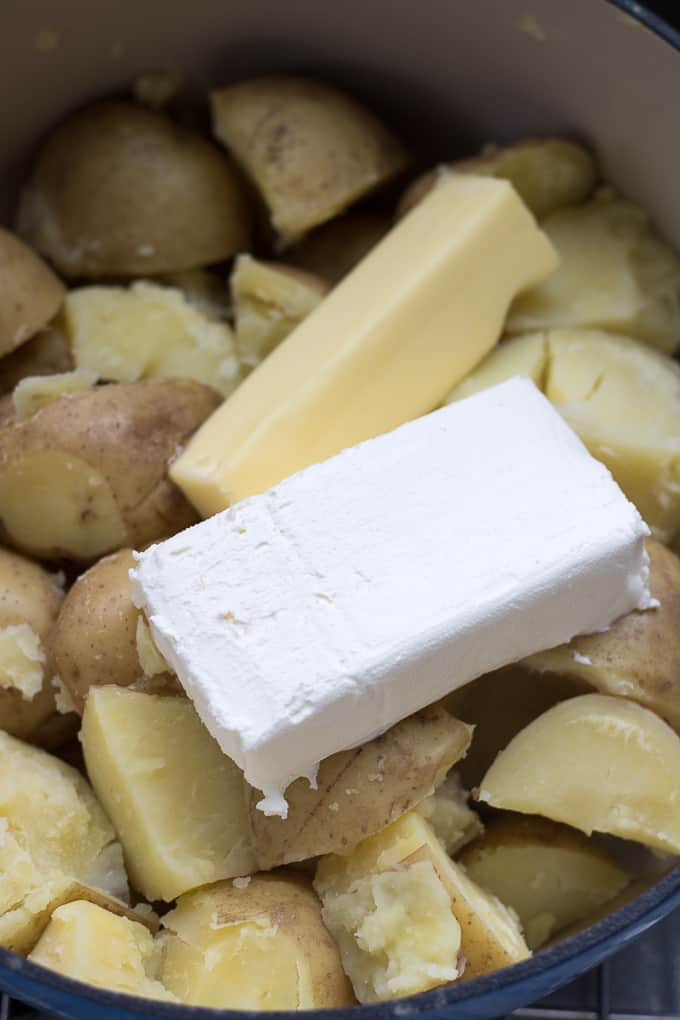 cream cheese and butter in cooked potatoes