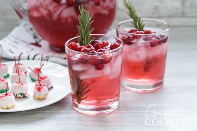 holiday punch glasses with spiked cherries on a plate