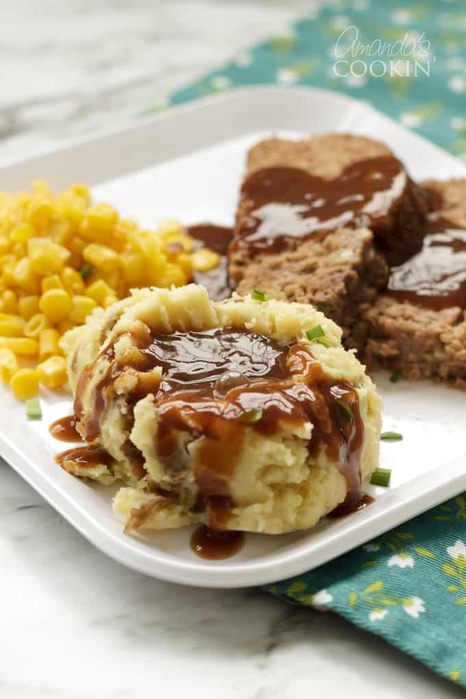 mashed potatoes and gravy on plate