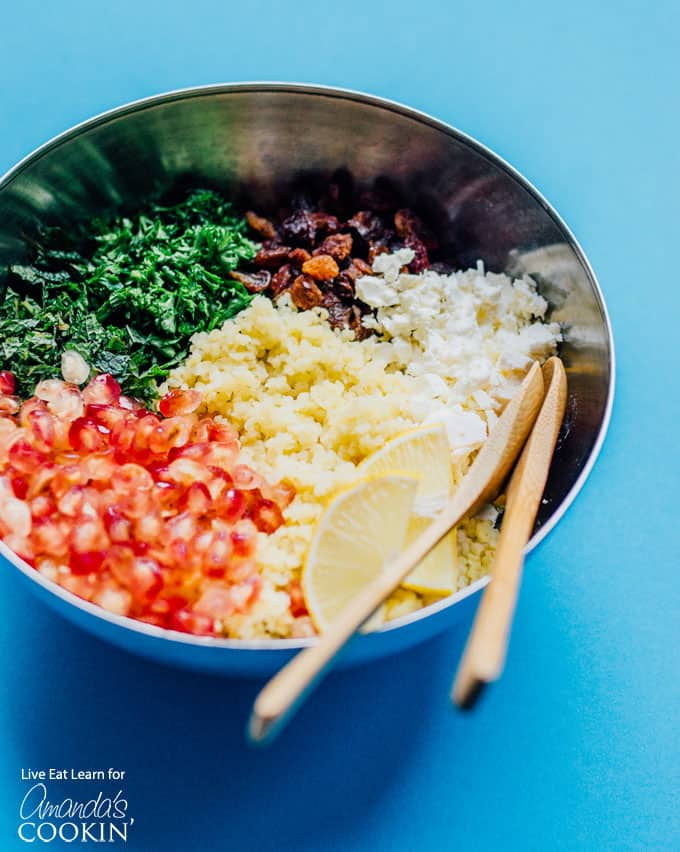 Ingredients for holiday grain salad in a bowl. Mix together