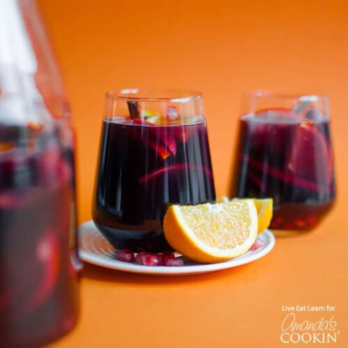pomegranate sangria with an orange wedge