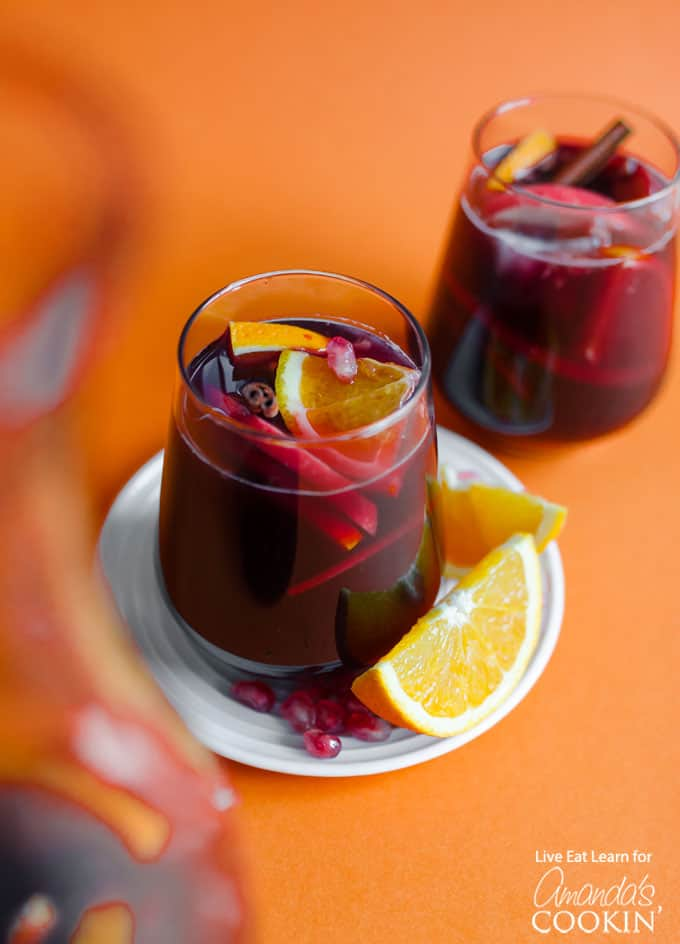 Glass of pomegranate sangria with orange slice