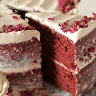 This Red Velvet Cake recipe is a 2-tiered cake recipe that uses red cocoa, espresso powder, and is topped with a delicious cream cheese frosting.