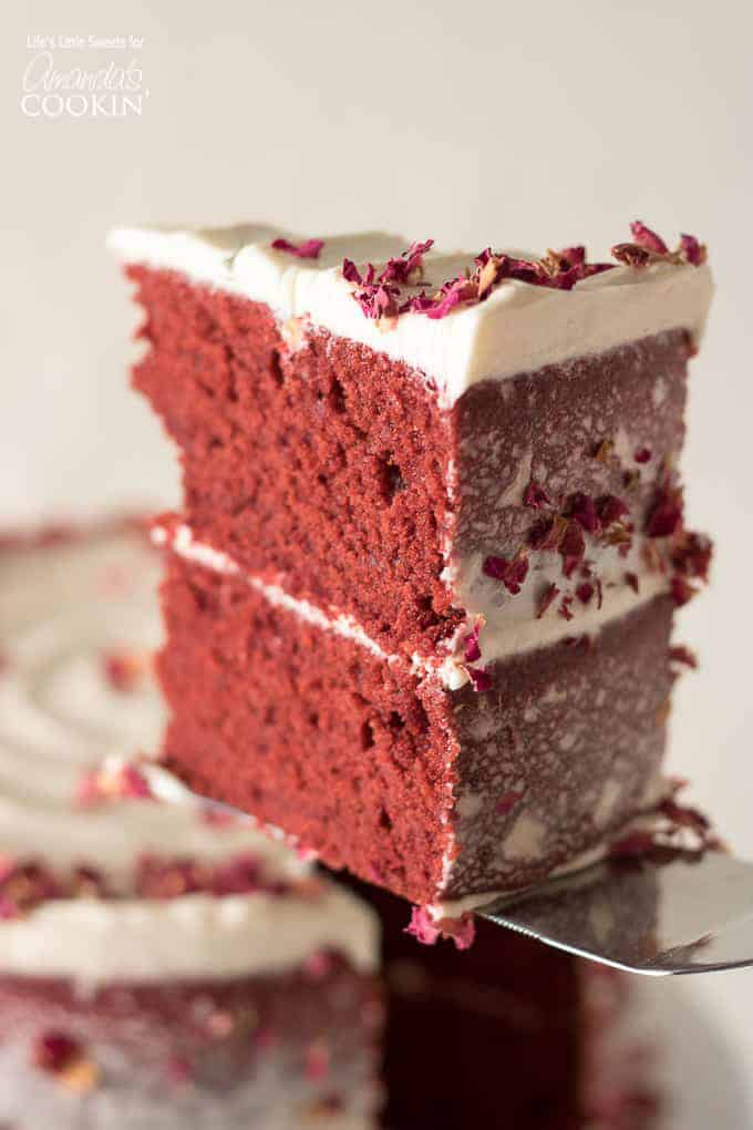 slice of red velvet cake with cream cheese frosting