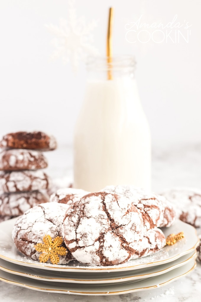 chocolate crinkle cookies on plate with bottle of milk
