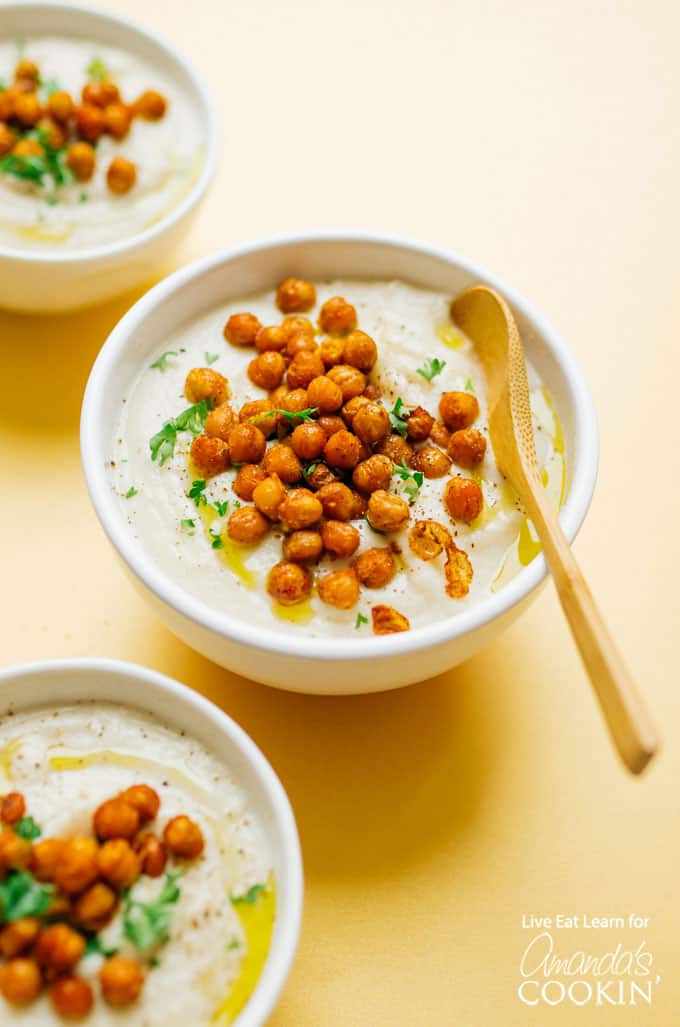 Crockpot creamy cauliflower soup in bowls with chickpeas