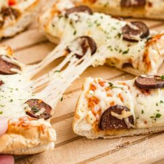 Stretched slices of pizza with cheese being pulled