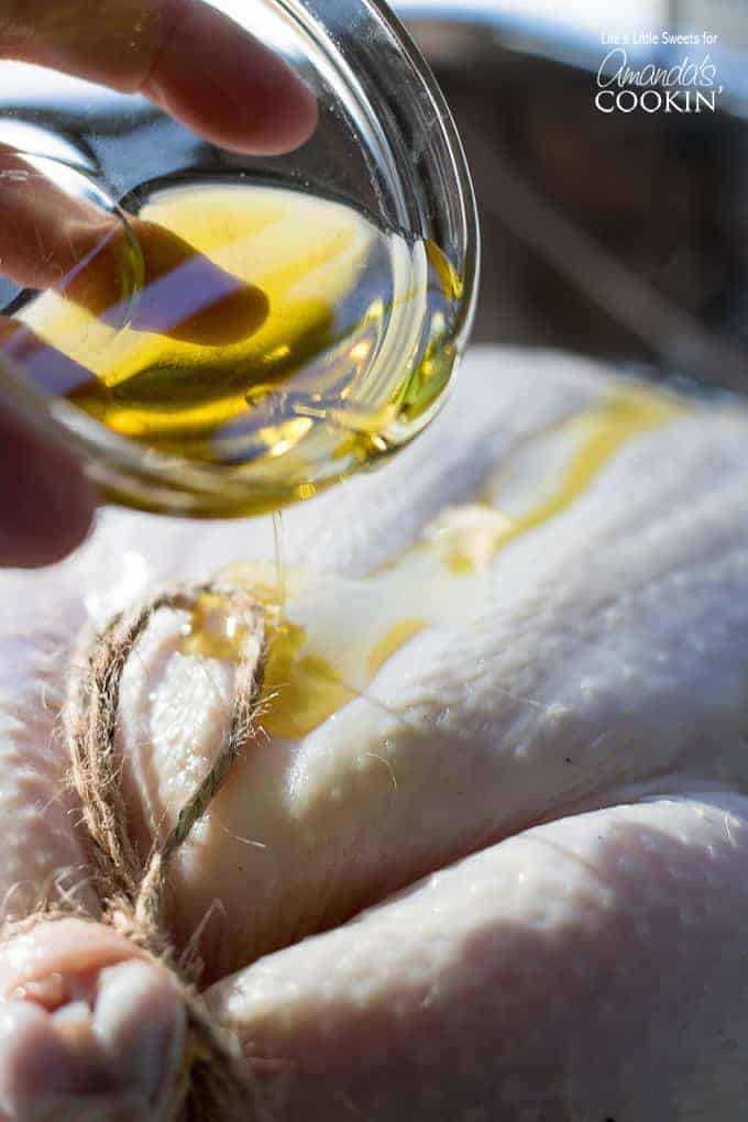 Adding olive oil to chicken