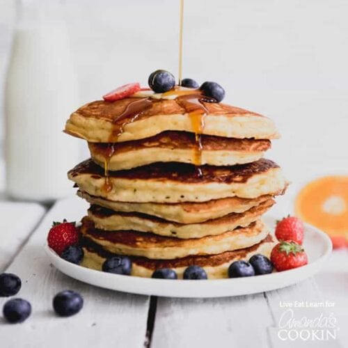 plate of stacked pancakes with blueberries