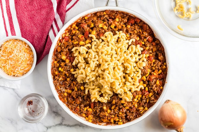 hamburger casserole in skillet with macaroni noodles