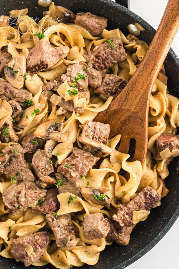 pan of beef stroganoff with wooden spoon