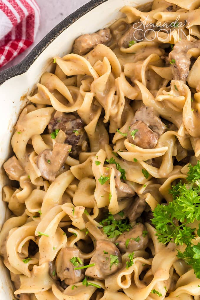 beef and noodles in white pan