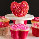 red heart cupcake standing on its side