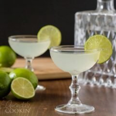 two gimlet cocktails in coupe glasses