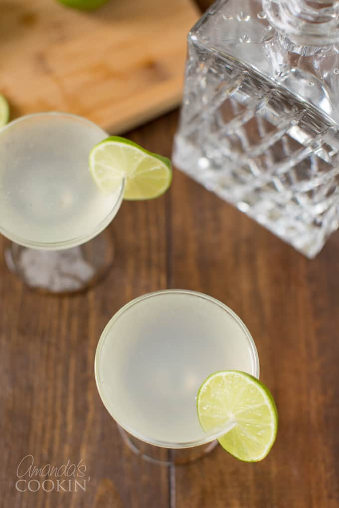 overhead view of two coupe glasses with gin gimlet cocktails