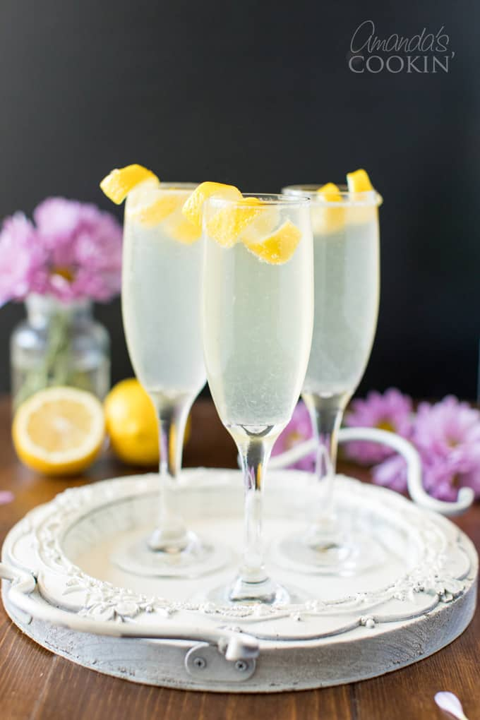 three champagne flutes of French 75