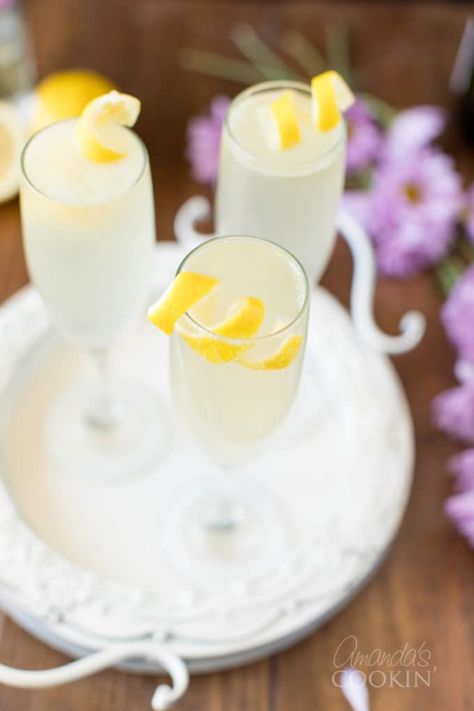 tray of French 75 cocktails in champagne flutes