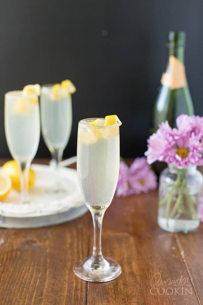 glass of French 75 with lemon twist