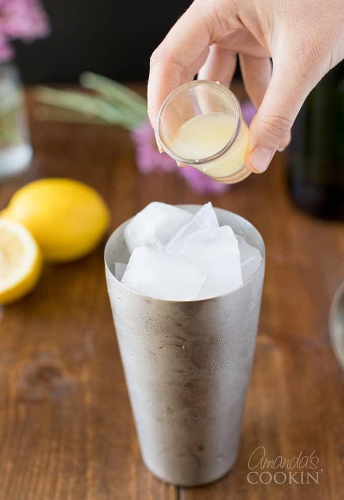 pouring lemon juice into cocktail shaker